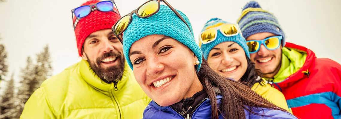 Group of snow skiers smiling